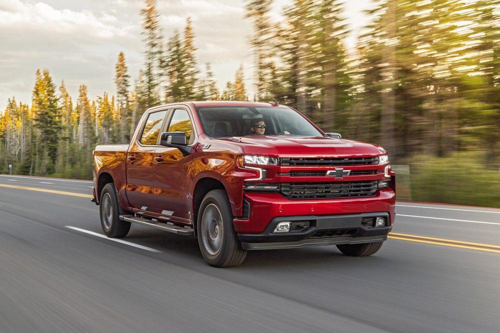 Diesel Chevrolet Silverado driving down road