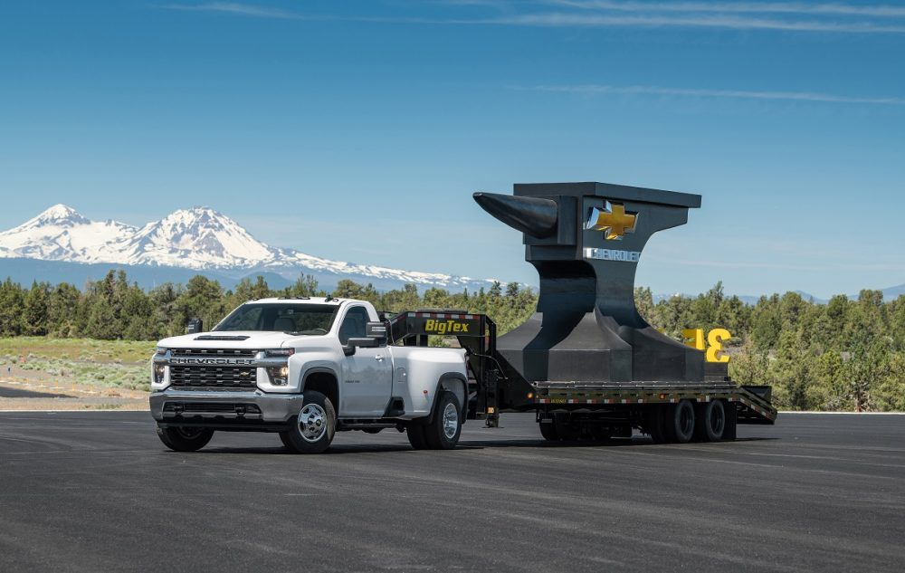 Front side view of Chevrolet Silverado 3500HD towing giant anvil