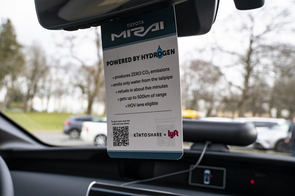 Toyota Mirai info card hanging from rearview mirror