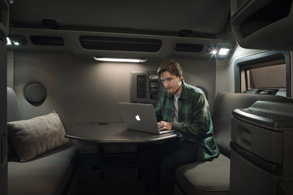 Volvo Trucks customer on a laptop, presumably checking out the digital integrated insurance pilot