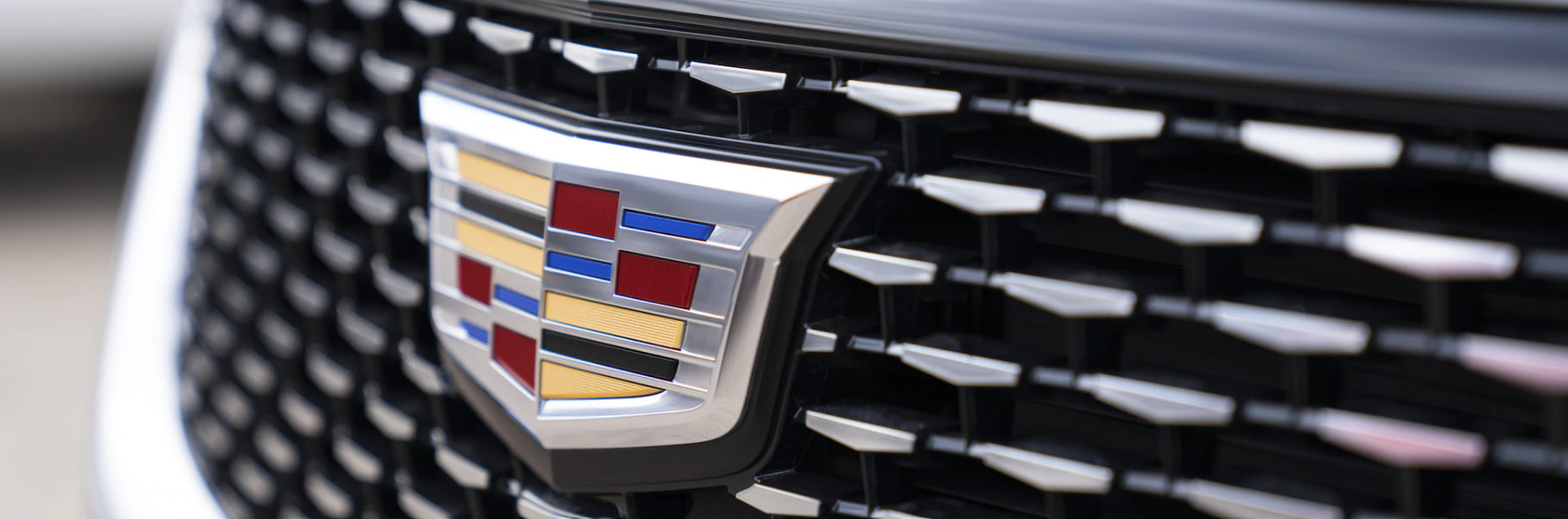Cadillac badge on the grille of the 2021 Cadillac XT6