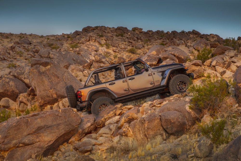 The 2021 Wrangler Rubicon 392 climbing a rocky hill