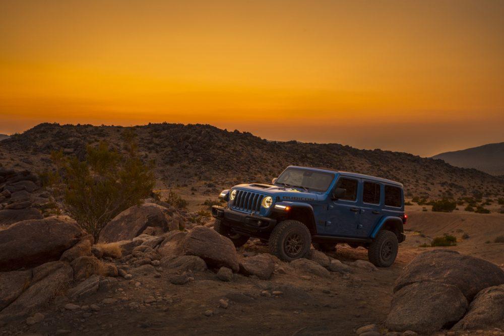 The 2021 Wrangler Rubicon 392 climbing rocks at sunset