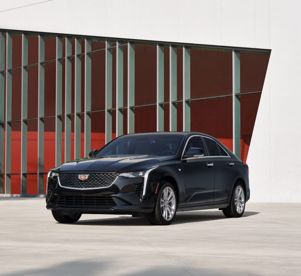 2021 Cadillac CT4 in front of a red and white geometric backdrop