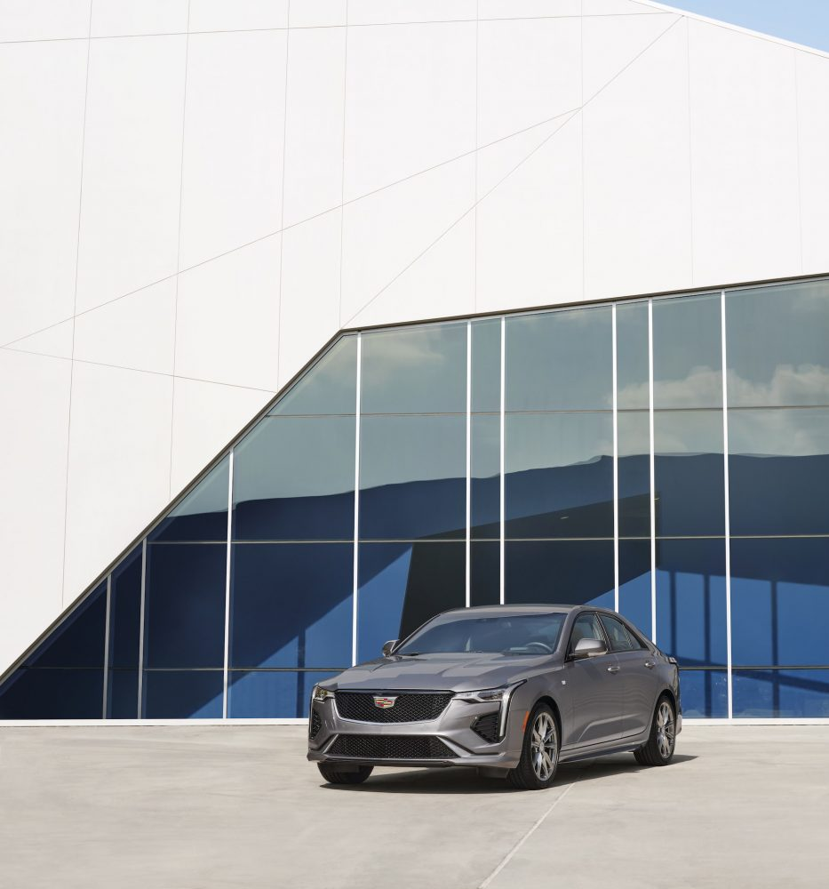 Front view of the 2021 Cadillac CT4 in front of a blue and white building