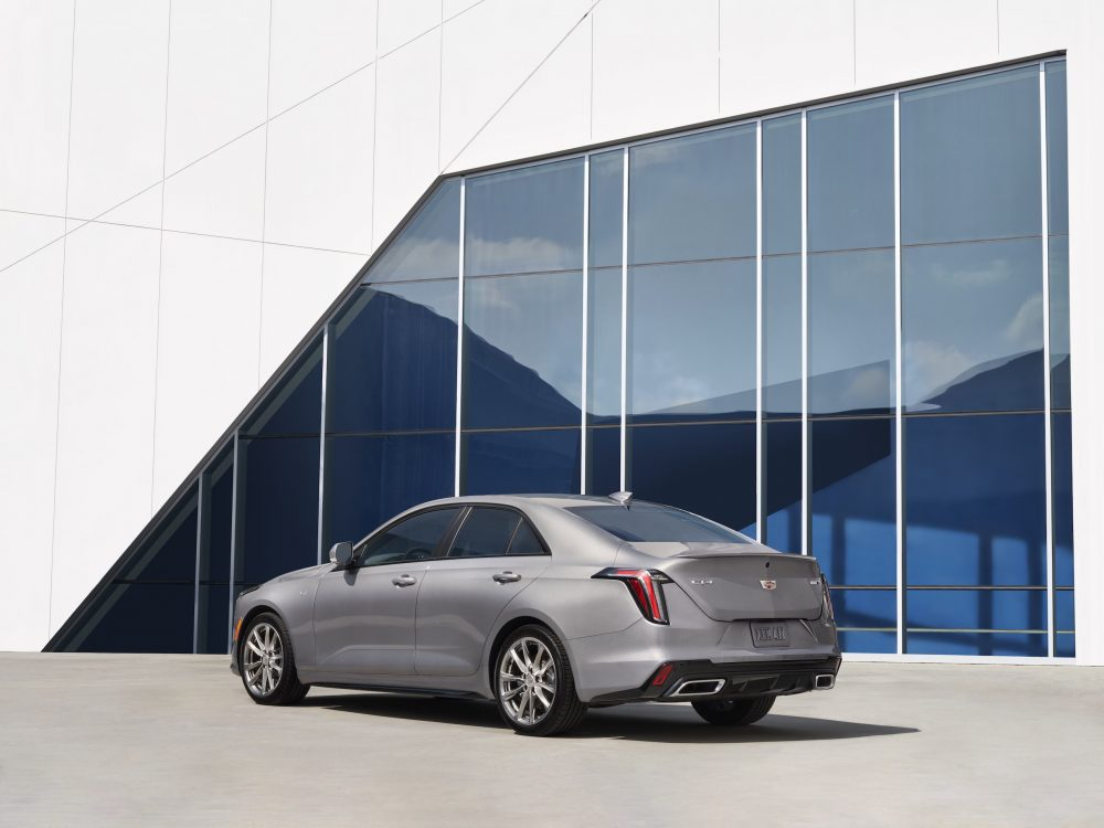 Rear view of the 2021 Cadillac CT4 in front of a blue and white building