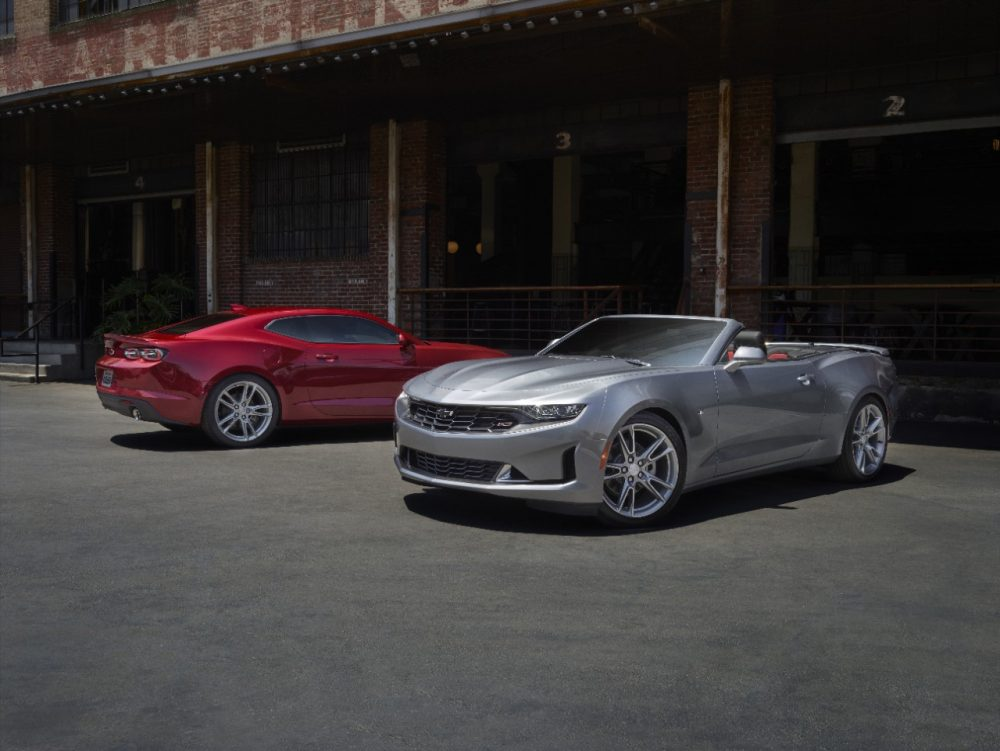 2021 Chevrolet Camaro LS and LT parked by a brick building