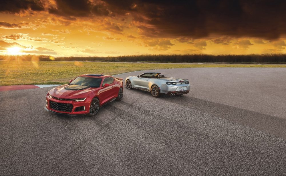 Two 2021 Chevrolet Camaro ZL1 models parked on a track at sunset