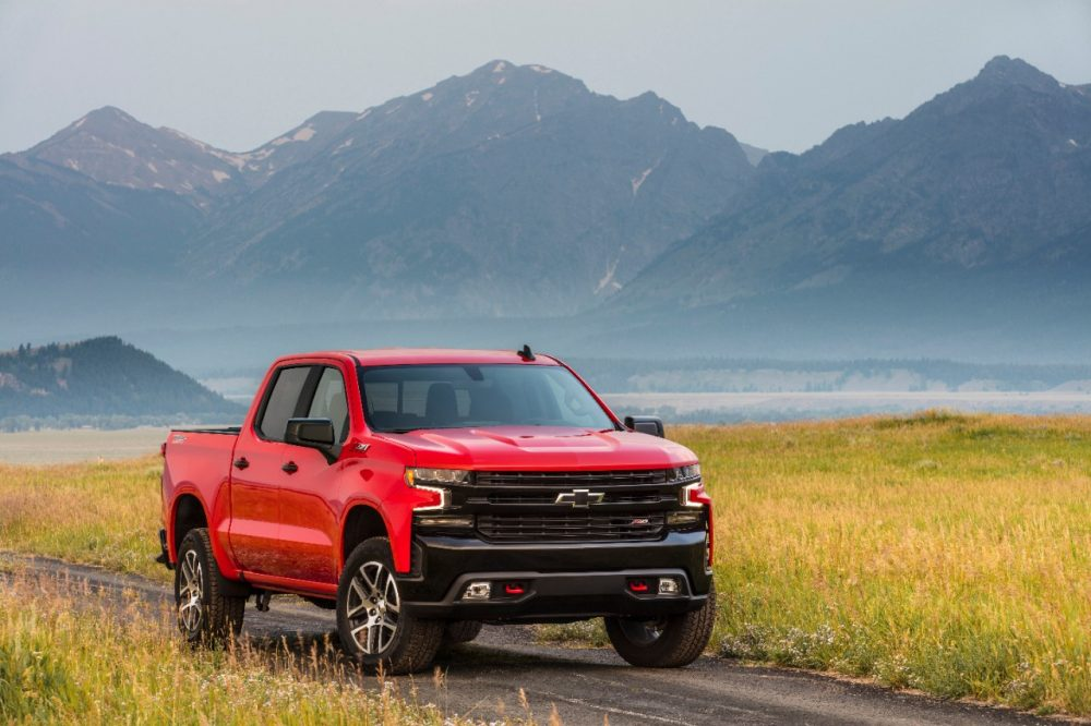 The 2021 Chevrolet Silverado LT Trail Boss in front of a mountain