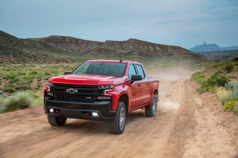 The 2021 Chevrolet Silverado LT Trail Boss on a dirt path