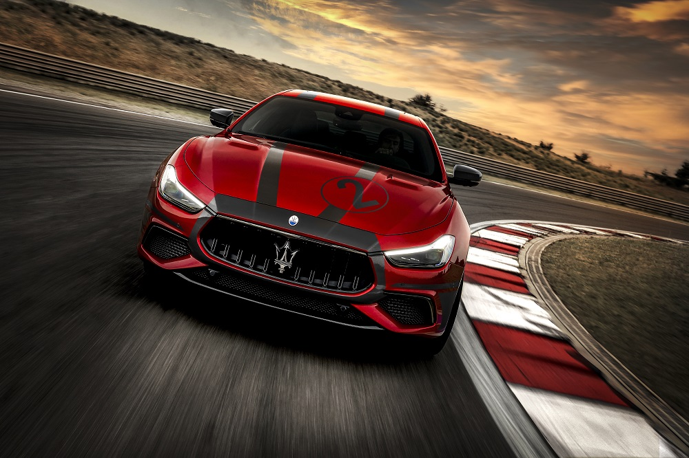 Red 2021 Maserati Ghibli Trofeo at the track for those who cannot access the MC20 Master Course