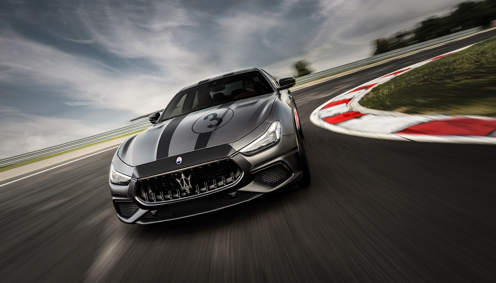 Red 2021 Maserati Ghibli Trofeo at the track for those who can't access the MC20 Master Course