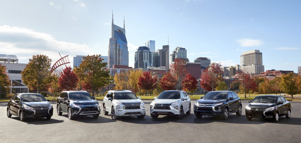 The 2021 Mitsubishi lineup in front of a city
