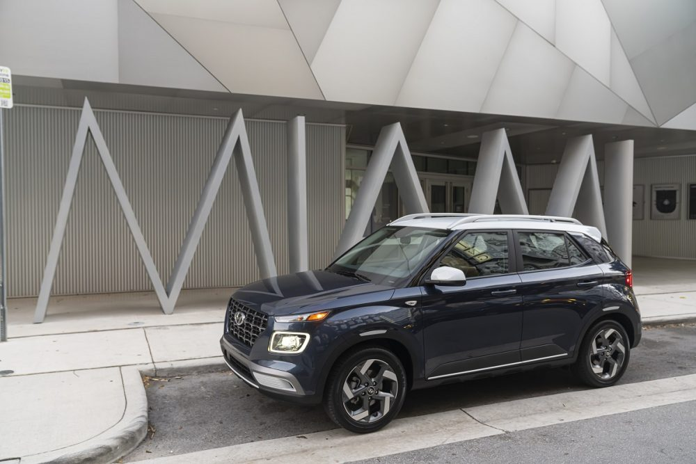 Side view of parked 2021 Hyundai Venue with contrast roof