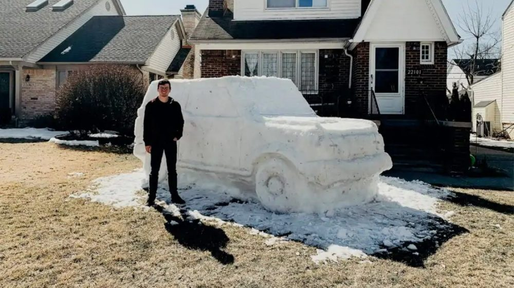 Jacob DiMaria and Ford Bronco snow sculpture