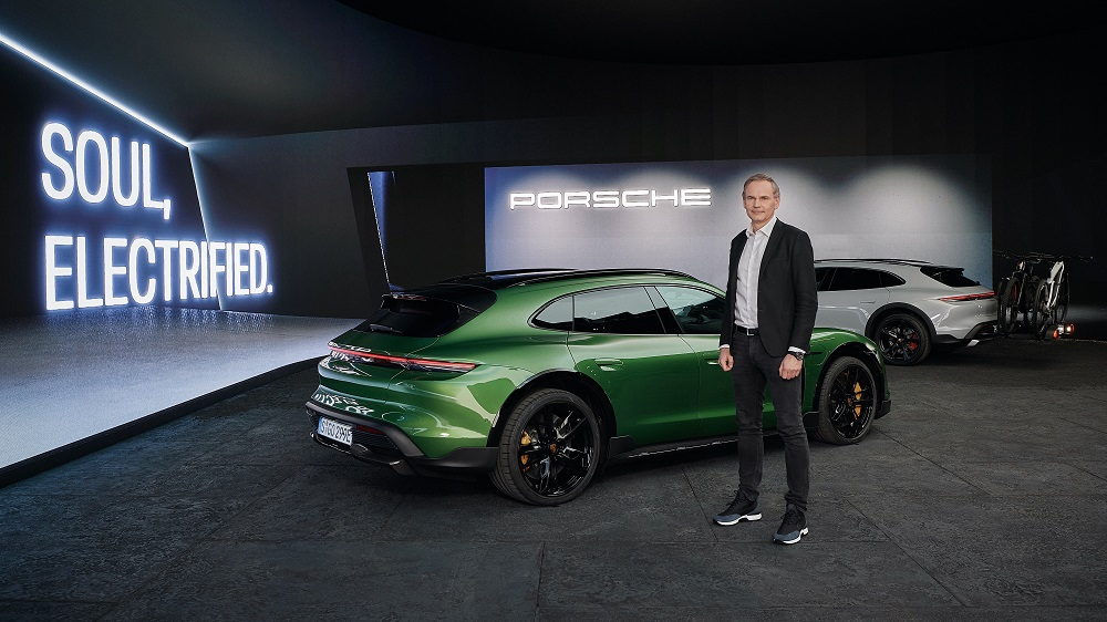 Porsche CEO Oliver Blume in front of a carbon neutral 2021 Taycan Turbo S Cross Turismo