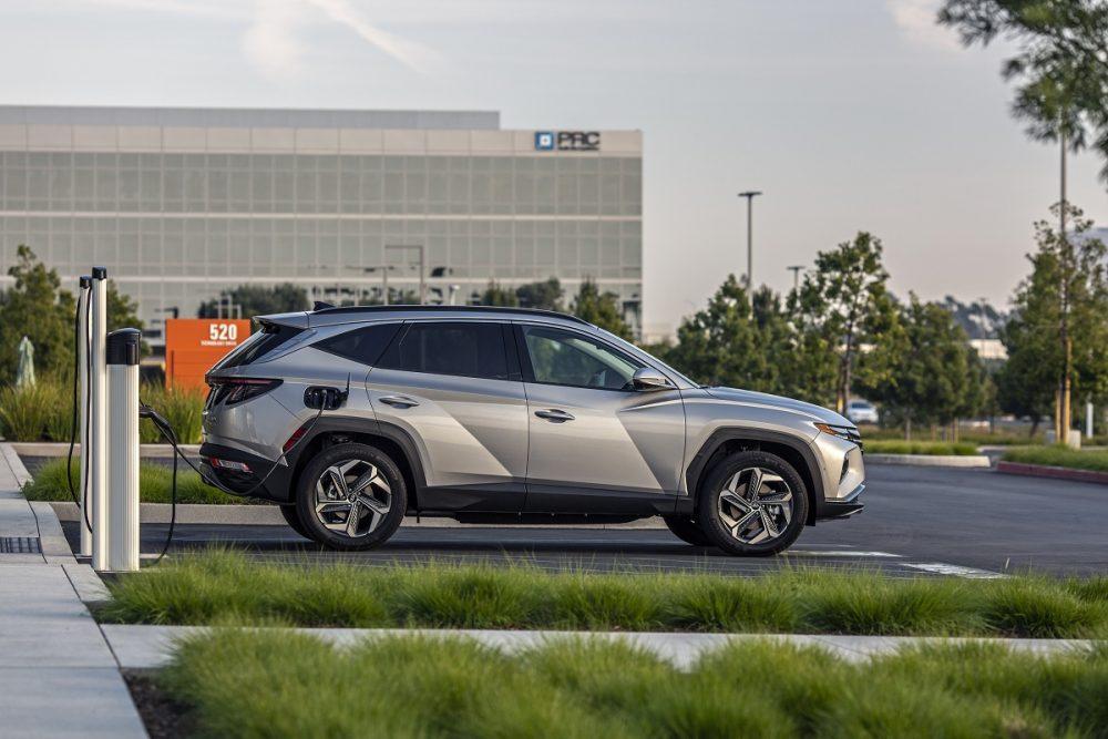 Side view of 2022 Hyundai Tucson PHEV at charging station