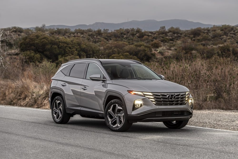 Front side view of 2022 Hyundai Tucson PHEV on road