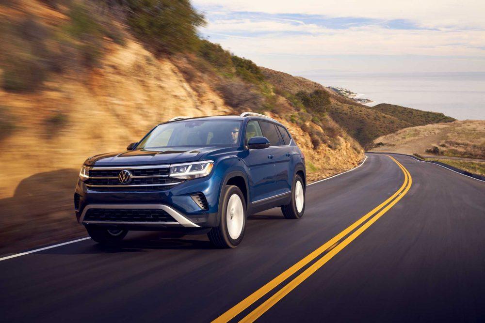 The 2021 Volkswagen Atlas driving down the road