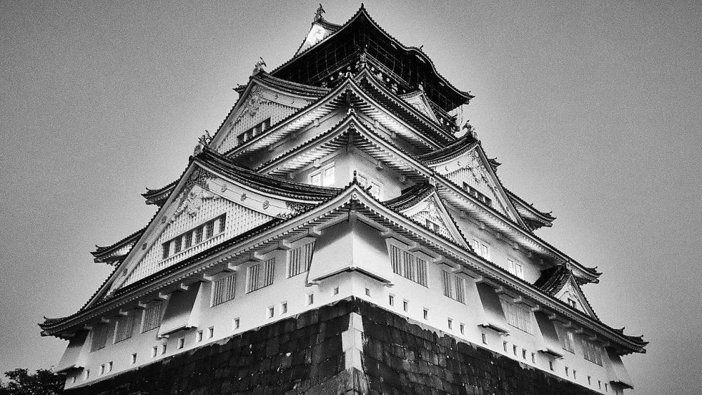 The landmark Osaka Castle in black and white