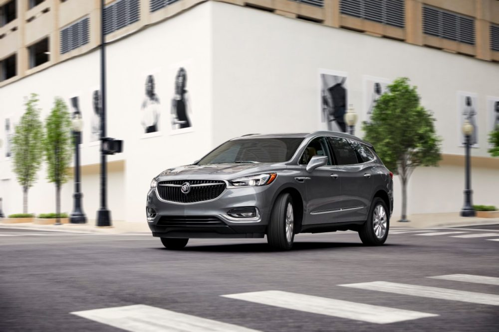 The 2021 Buick Enclave driving on the street