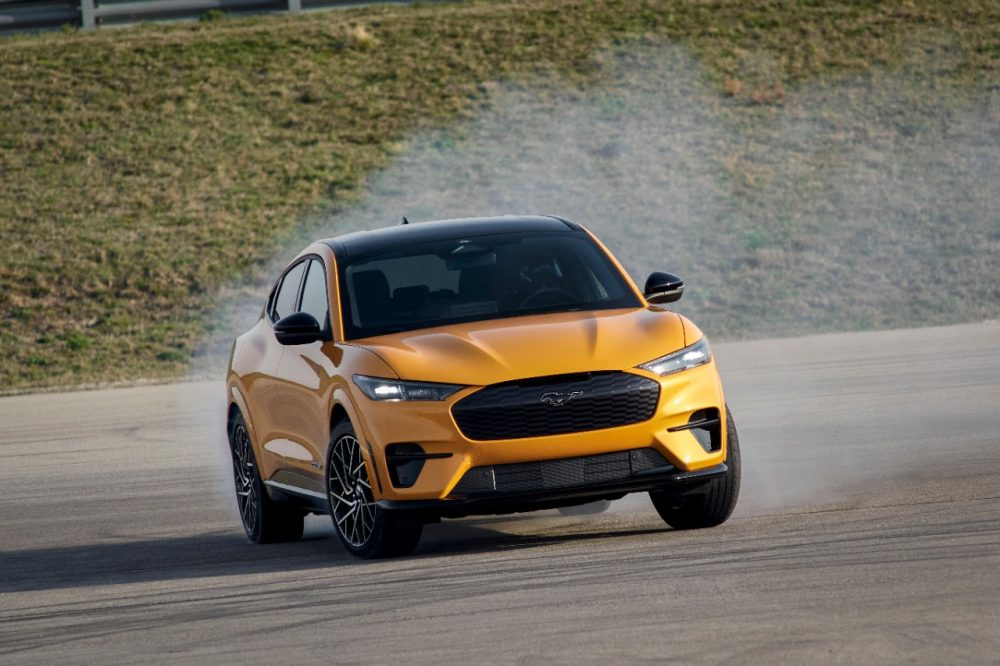 2021 Ford Mustang Mach-E GT in Cyber Orange with smoking tires