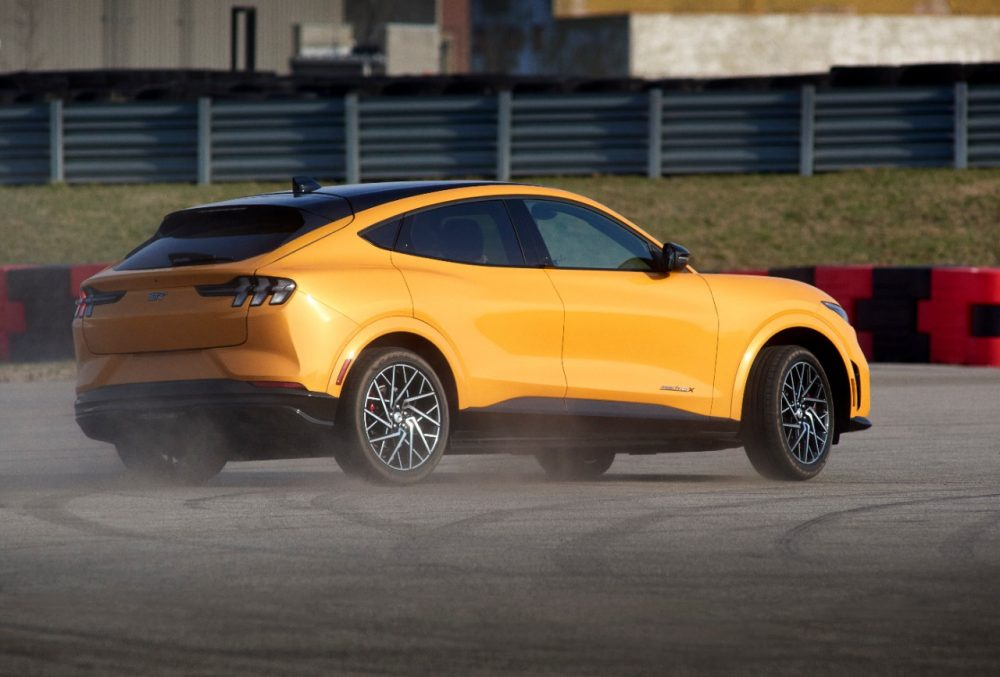 2021 Ford Mustang Mach-E GT in Cyber Orange smoking tires rear