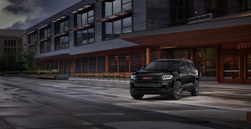 2021 GMC Acadia Elevation in front of a building