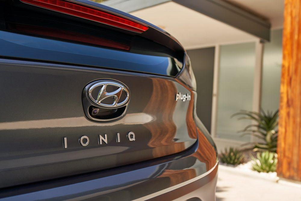Close-up of Hyundai badge and Ioniq Plug-In Hybrid nameplate