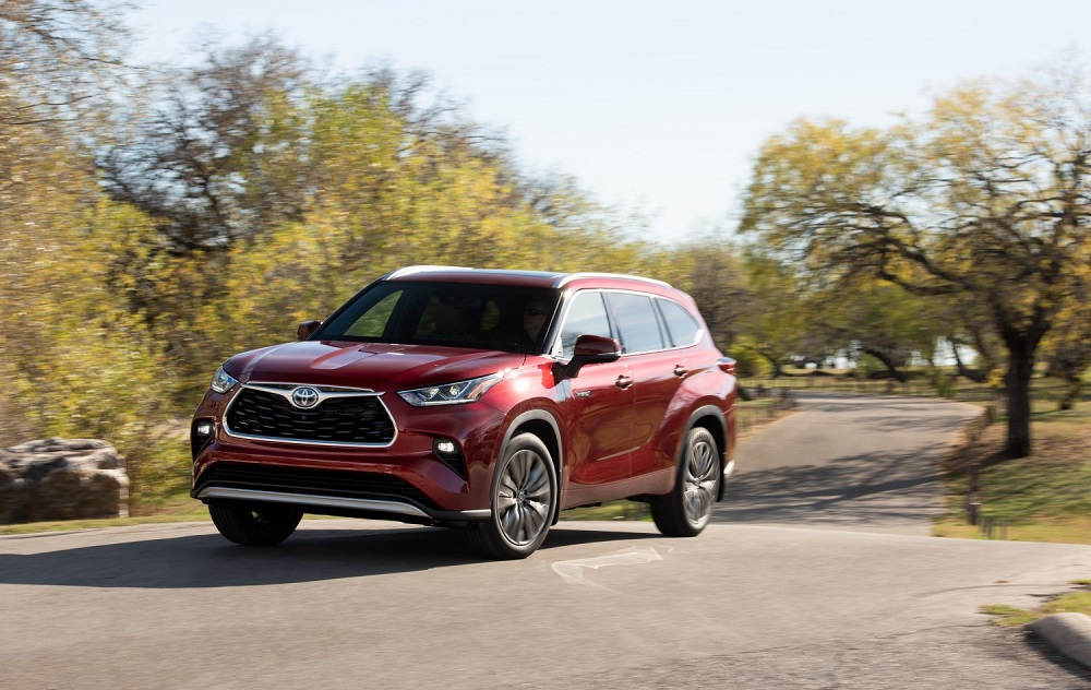 2021 Toyota Highlander Platinum Hybrid AWD in Ruby Red Pearl, one of the best performers for Toyota Canada March sales