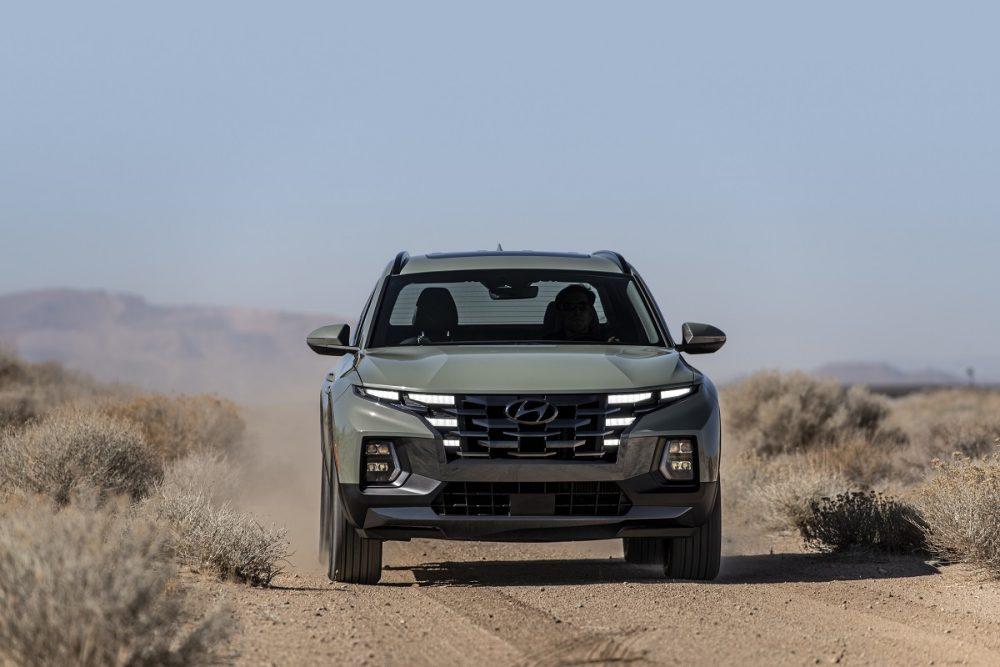 Front view of 2022 Hyundai Santa Cruz driving on off-road trail