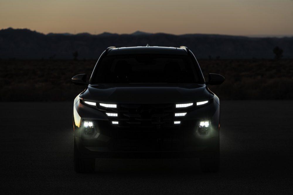 Front view of 2022 Hyundai Santa Cruz grille and headlamps in the dark