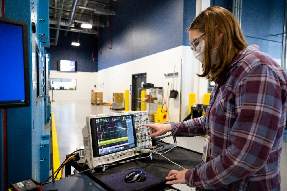 Battery validation engineer Mary Fedrick uses an Oscilloscope to test a battery at the the Battery Benchmarking and Test Laboratory in Allen Park, Michigan