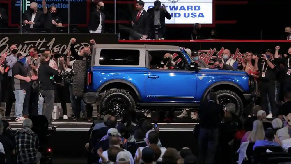 A representation of the Ford Bronco First Edition VIN 001 on the auction block at the Barrett-Jackson Auction Scottsdale