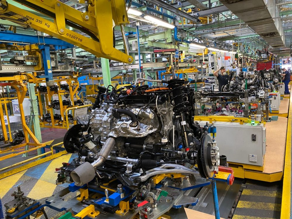 A 2.5-liter Duratrac hybrid engine being built on a Ford assembly line