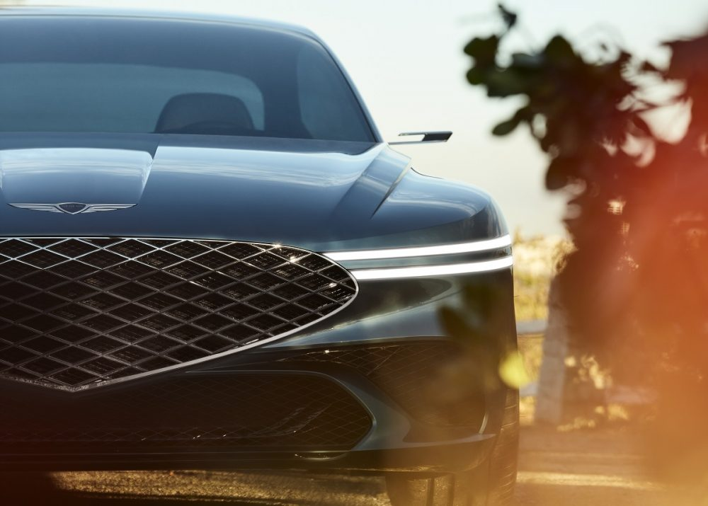 Close-up view of Genesis X Concept grille and headlamps