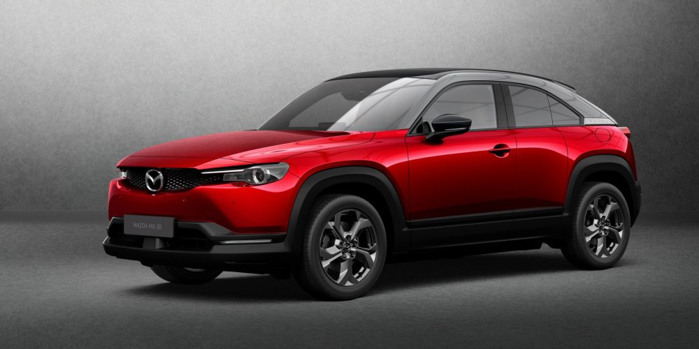 2022 Mazda MX-30 front side view in red with gray backdrop