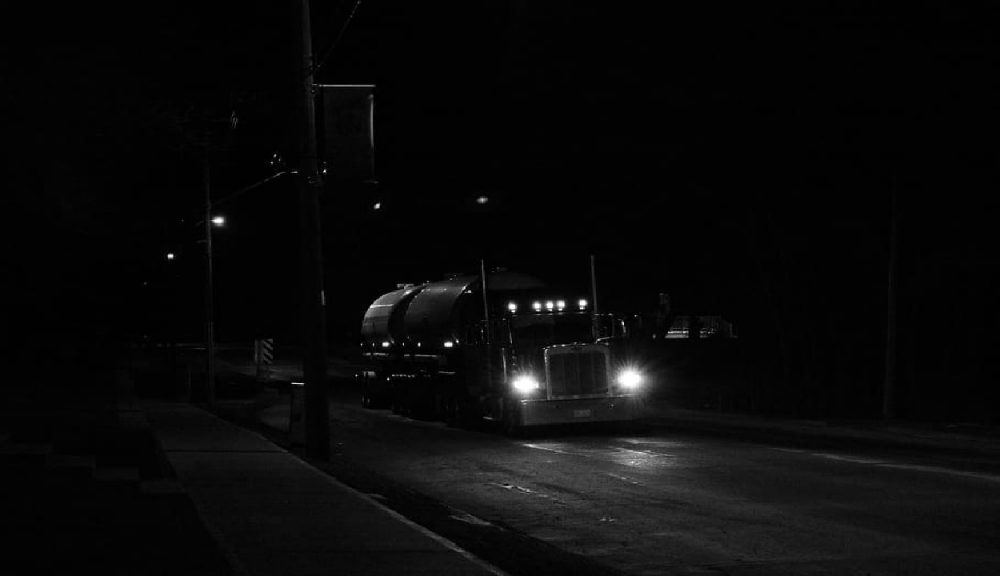 A scary truck driving at night