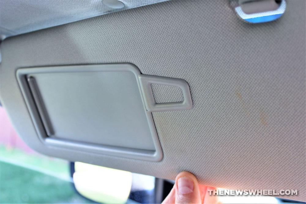sun visor in car with vanity mirror