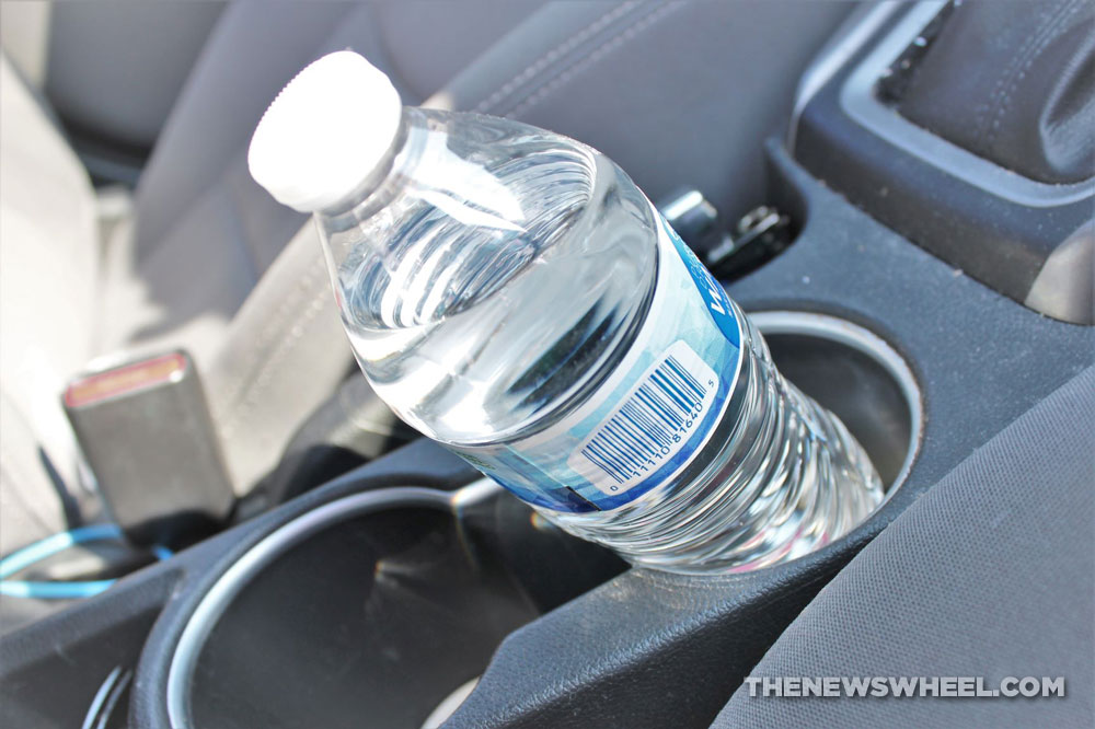 water bottle in car cup holder for drinking