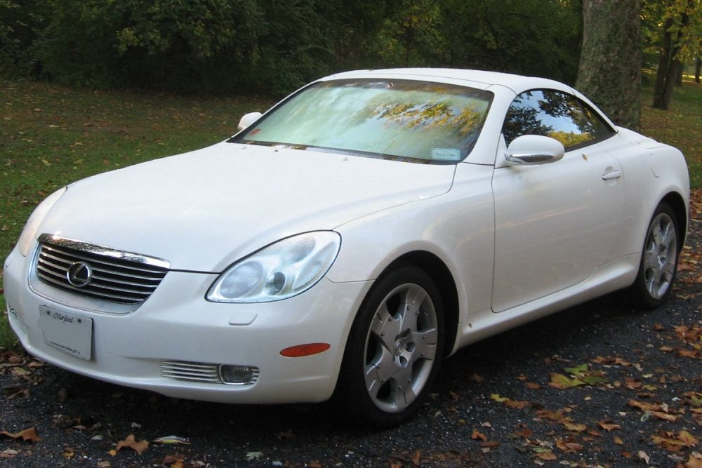 White Lexus SC 430 parked in a driveway