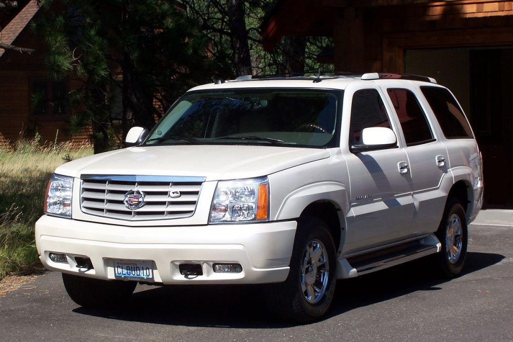 White 2005 Cadillac Escalade parked in a driveway