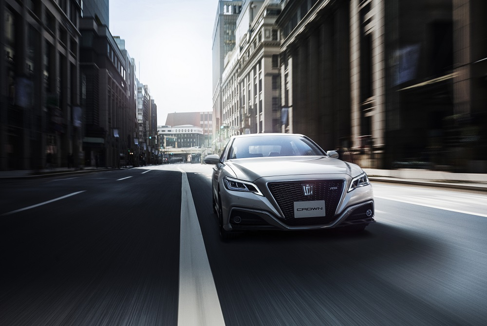 2018 Toyota Crown driving down a city street