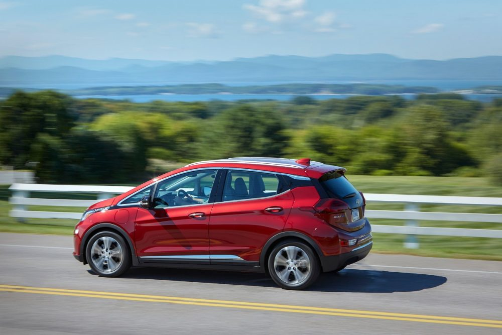Side view of 2021 Chevrolet Bolt EV driving down road