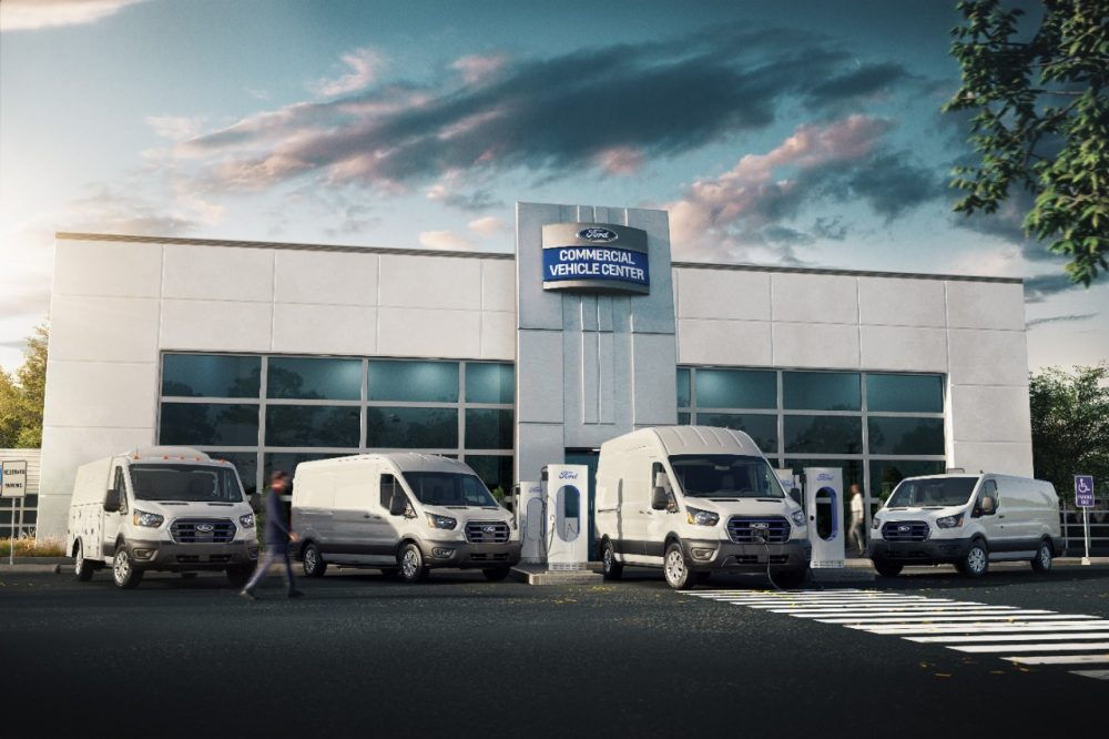 2022 Ford E-Transit fleet in front of a Ford Commercial Vehicle Center