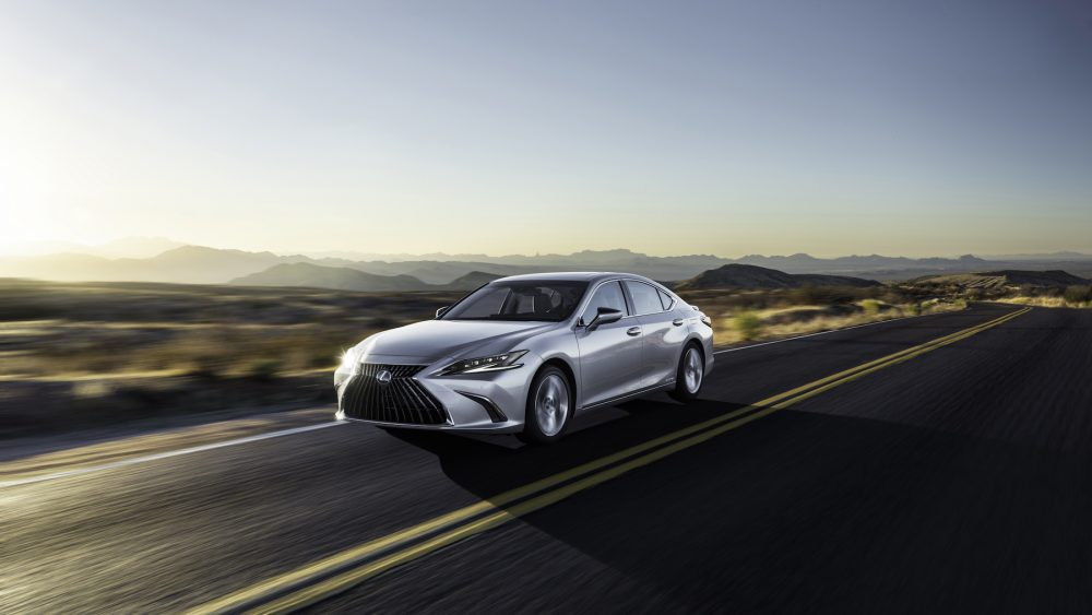 Silver 2022 Lexus ES driving down a road
