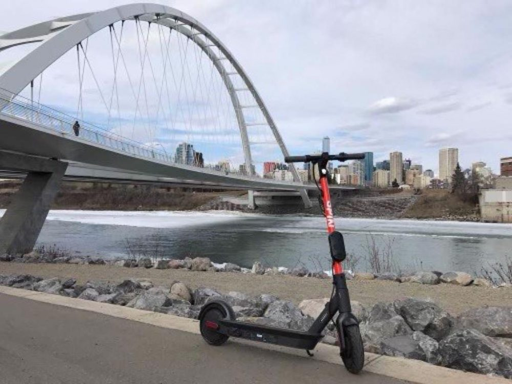 a Spin scooter by the Walterdale Bridge in Edmonton, Alberta, Canada
