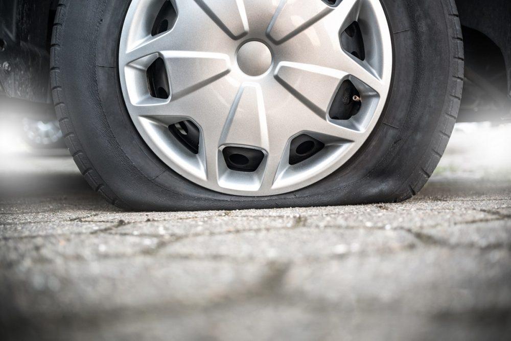 Close up of flat tire on pavement