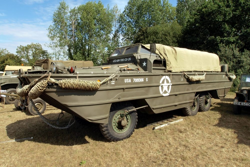 Historic 1943 GMC DUKW 353 Duck U.S. Military Vehicle in a field