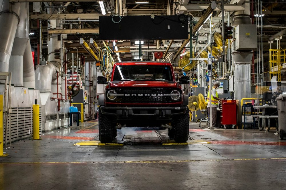 The face of a red Ford Bronco on the line at Michigan Assembly Plant
